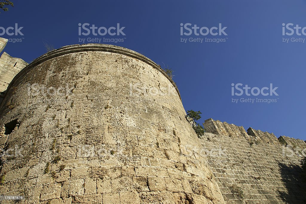 Medieval city walls in Rhodes town, Greece royalty-free stock photo