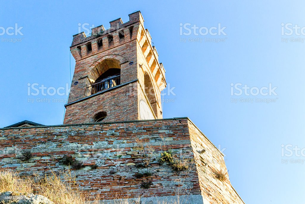 Medieval crenellated brick wall Clock tower stock photo