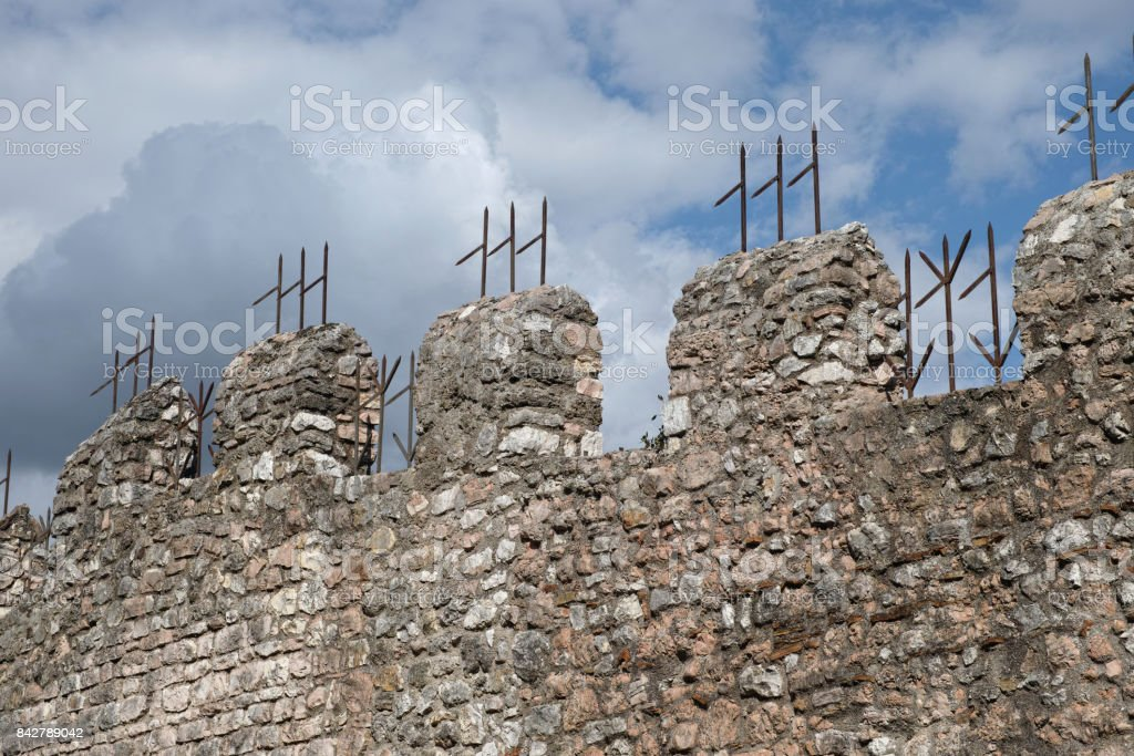 medieval crenellated walls stock photo