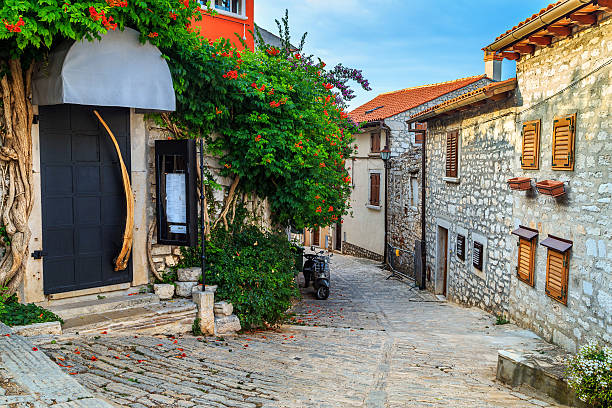 Medieval Croatian old street,with flowered entrance in Rovinj,Europe stock photo