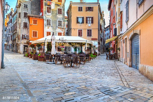 Spectacular stone paved street with colorful houses and typical street cafe bar, Rovinj old town,Istria region,Croatia,Europe