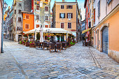 Medieval Croatian old street,with street cafe in Rovinj,Europe
