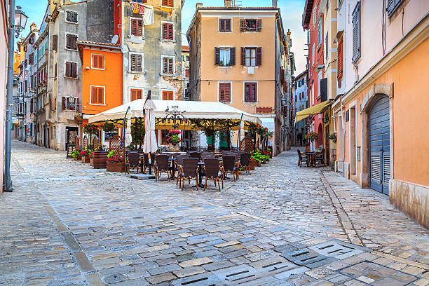 Medieval Croatian old street,with street cafe in Rovinj,Europe stock photo