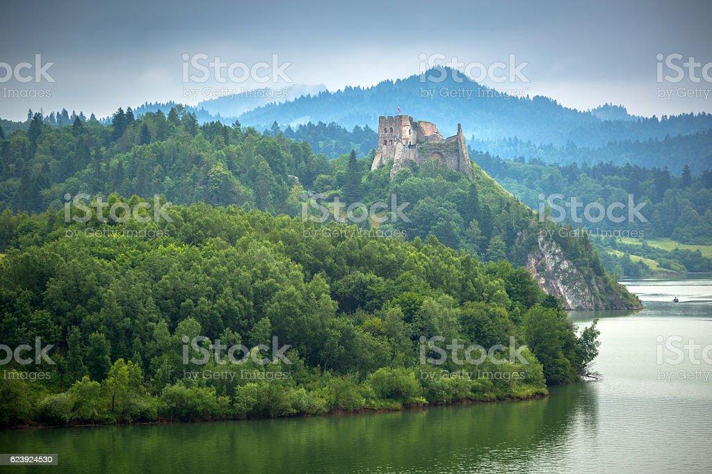 Medieval Czorsztyn castle at the lake in Poland stock photo