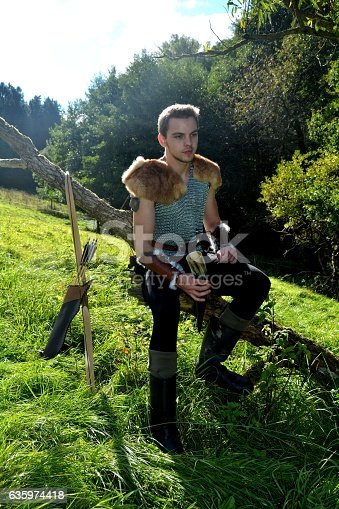 630040004istockphoto Medieval dressed one man, holds drinking horn high in  hand 635974418