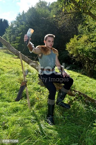 630040004istockphoto Medieval dressed one man, holds drinking horn high in hand 635975056