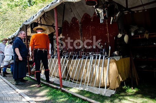 Soest, Germany - August 4, 2019: Medieval festival participants near medieval gun smith shop. Soester Fehde 2019