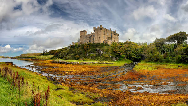 Medieval fortress Dunvegan Castle (Isle of Skye, Scotland) Medieval fortress Dunvegan Castle (Isle of Skye, Scotland) - HDR panorama isle of skye stock pictures, royalty-free photos & images
