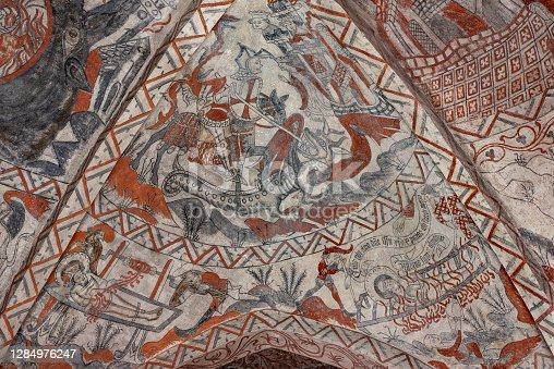 istock medieval fresco of  St George and the Dragon and the martyrium of St Lawrence 1284976247