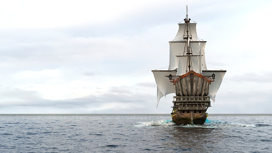 A medieval frigate sailing on a boundless blue sea. Concept of sea adventures in the middle ages.