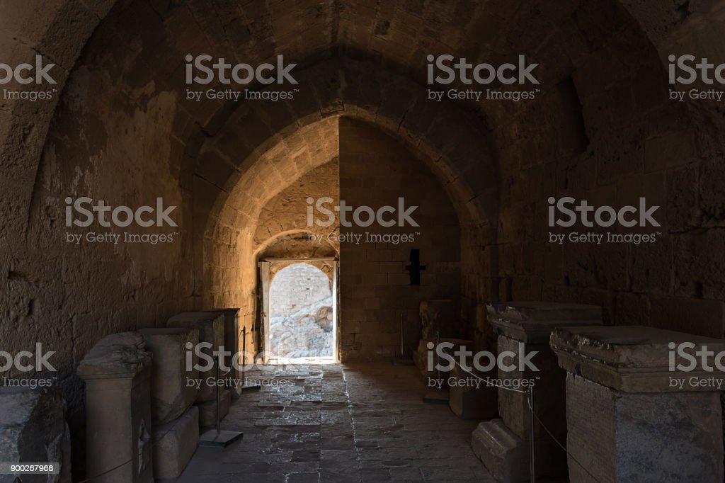 Medieval gate and corridor of Acropolisof Lindos (Rhodes, Greece) stock photo