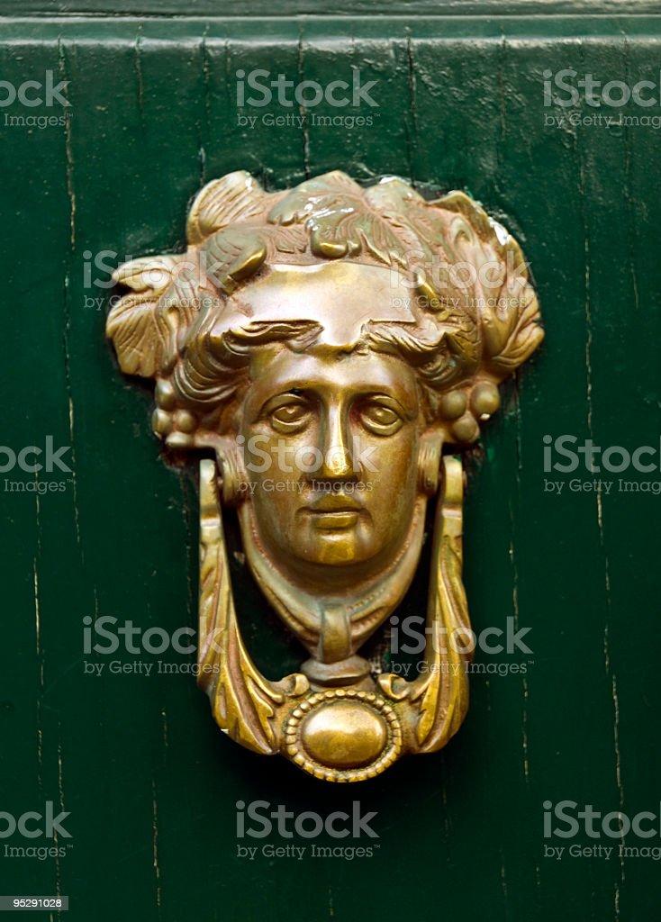 Medieval Gold Door Knocker royalty-free stock photo