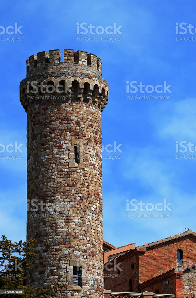 Medieval guard tower in the countryside, against a blue sky. stock photo