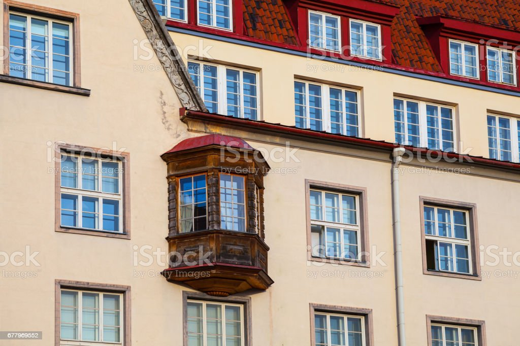 Medieval house with wooden balcony on City Hall Square of Old Tallinn, Estonia royalty-free stock photo