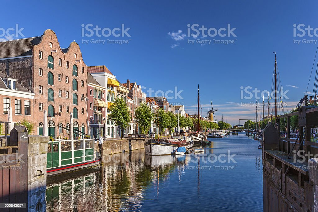 Medieval houses alongside a canal in Delfshaven, The Netherlands stock photo