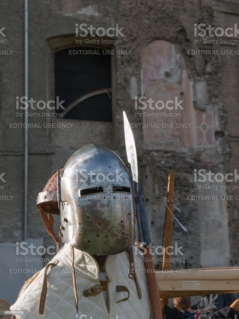 Medieval Iron Helmet and Pole Weapon stock photo