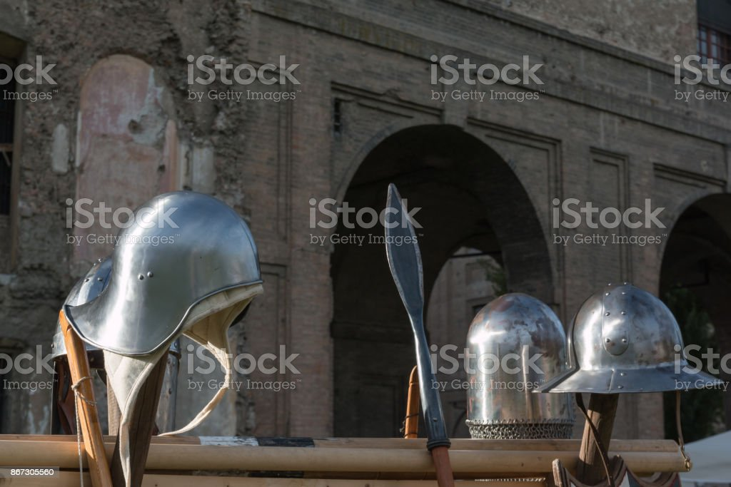 Medieval Iron Helmets and Pole Weapon In Parma, Italy stock photo