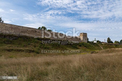 Medieval Izborsk fortress wall,  Talavskaya tower and Chapel of the Korsun Icon of the Mother of God. Izborsk, Pskov region, Russia.