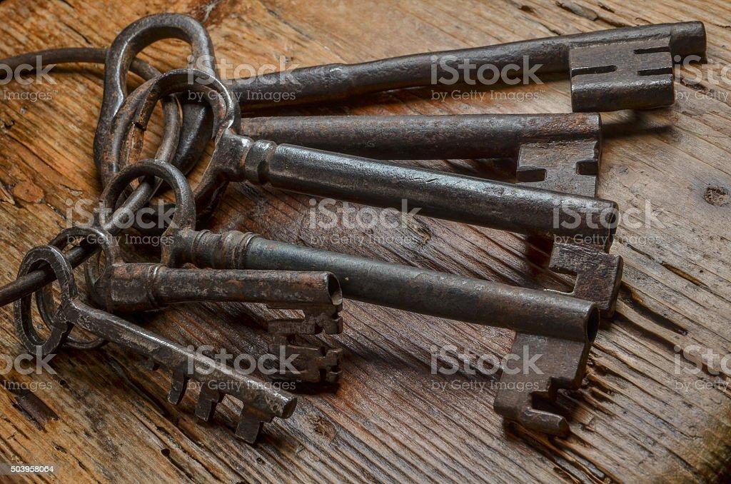 medieval keys on wood table stock photo
