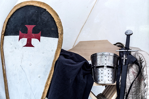 Medieval knight equipment in old sleeping tent
