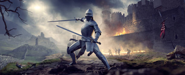 medieval knight in armour holding two swords near burning castle - periodo medievale foto e immagini stock