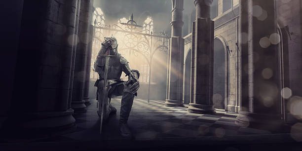 medieval knight in armour kneeling with sword inside castle - the crusades stock photos and pictures