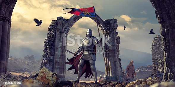 A medieval knight wearing full armour, chainmail and cape, standing heroically, holding a banner flag with sword drawn. The knight stands on rocks in front of an archway of ruins. Other infantry are in the background, along with ravens flying nearby in the dramatic evening sky.