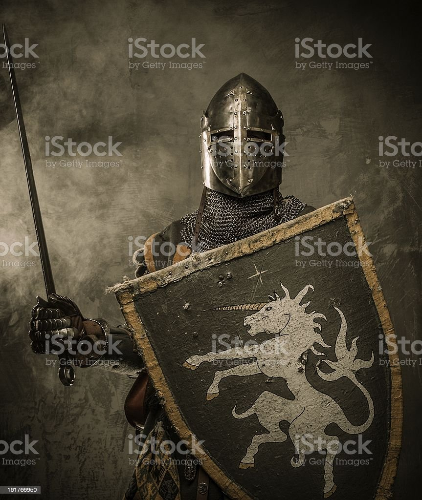 Medieval knight in full armor ready for battle stock photo