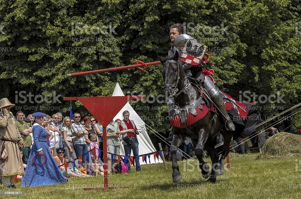 Medieval knight on horseback showing their skills royalty-free stock photo