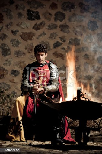 Mystical portrait of medieval Knight with sword and fire ,selective focus, very creative color retouching and hard lighting to underline the ancient medieval time,vignetting and possible noise see more: