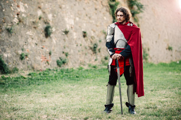 medieval knight standing alone near the castle - knights templar stock pictures, royalty-free photos & images