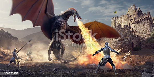 Fantasy image of four Medieval knights wearing suits of amour, some armed with spears, surrounding a huge dragon. The dragon has wings spread and breathes fire onto the ground, close to the knights, knocking one over with the blast. The battle occurs near a stone castle on a bright evening.