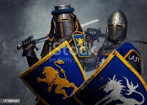 istock Medieval knights on grey background. 137865052