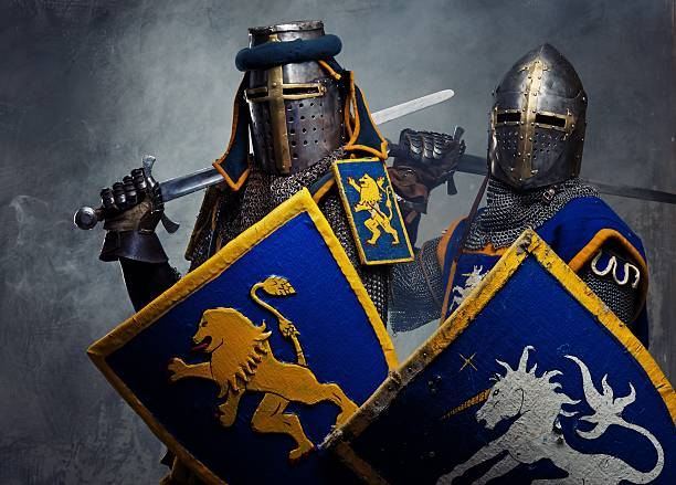Medieval knights on grey background. stock photo