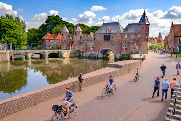 Medieval Koppelpoort town wall and gate over the Eem river in Amersfoort stock photo