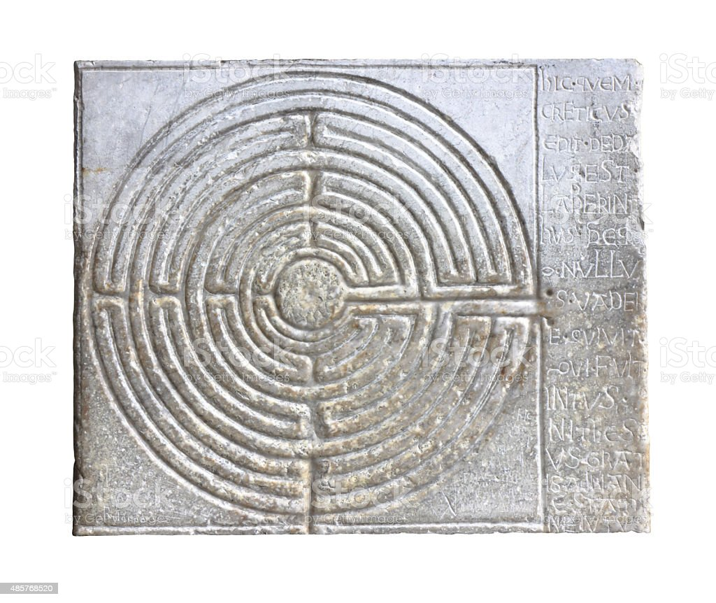 Medieval labyrinth carved on the facade of a Romanesque church stock photo