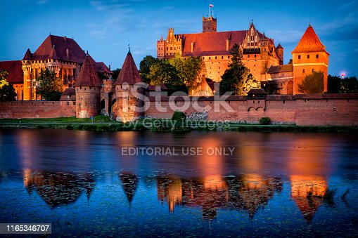 Malbork, Poland - July 27, 2019:Medieval Malbork castle by night, Poland. The largest castle in the world by surface area, and the largest brick building in Europe. Historical capitol of the Teutonic Order - Crusaders