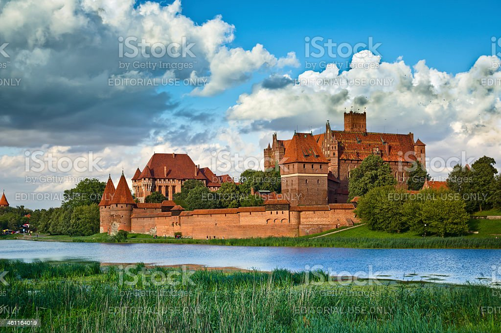 Medieval Malbork castle on the river Nogat royalty-free stock photo