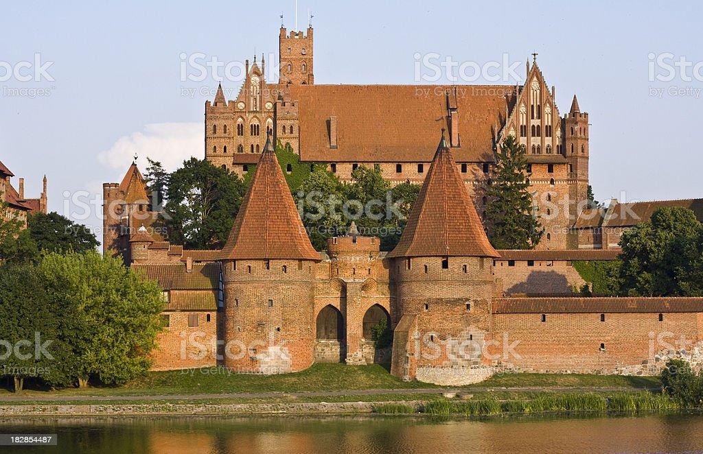 Medieval Malbork castle on the river Nogat, Poland stock photo