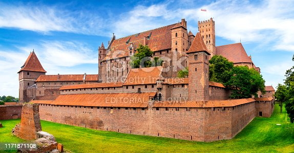 Malbork, Poland - July 27, 2019:Medieval Malbork Castle, Poland. The largest castle in the world by surface area, and the largest brick building in Europe. Historical capitol of the Teutonic Order - Crusaders