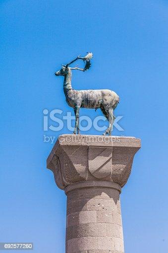 istock Medieval Mandraki Deer Statue of Rhodes, Greece 692577260