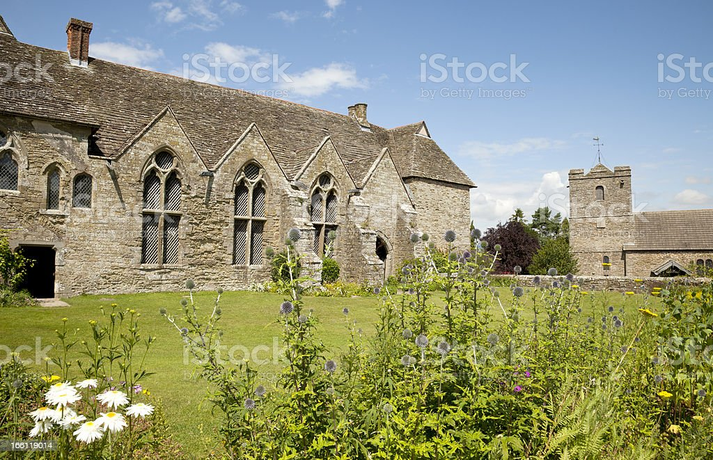 Medieval Manor House and Church stock photo