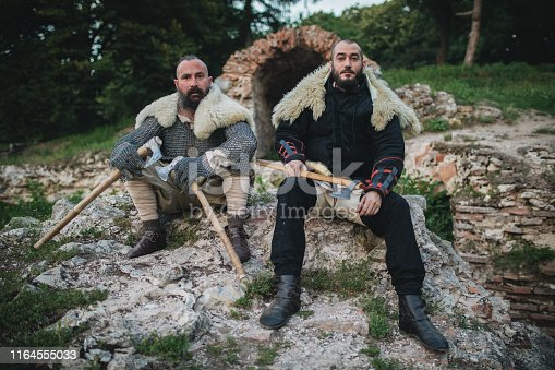 istock Medieval men with axes and armor 1164555033