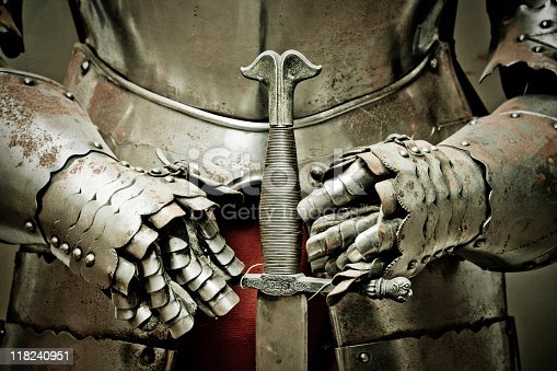 istock Medieval metal armour and sword. 118240951