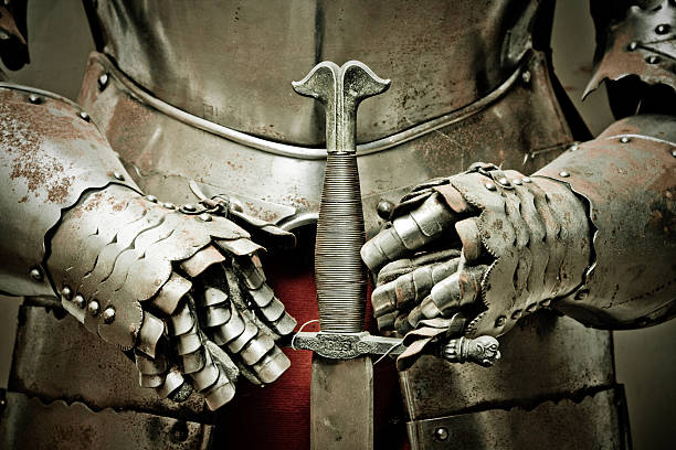 Medieval metal armour and sword. stock photo