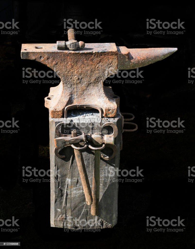 Medieval metal blacksmith anvil stock photo