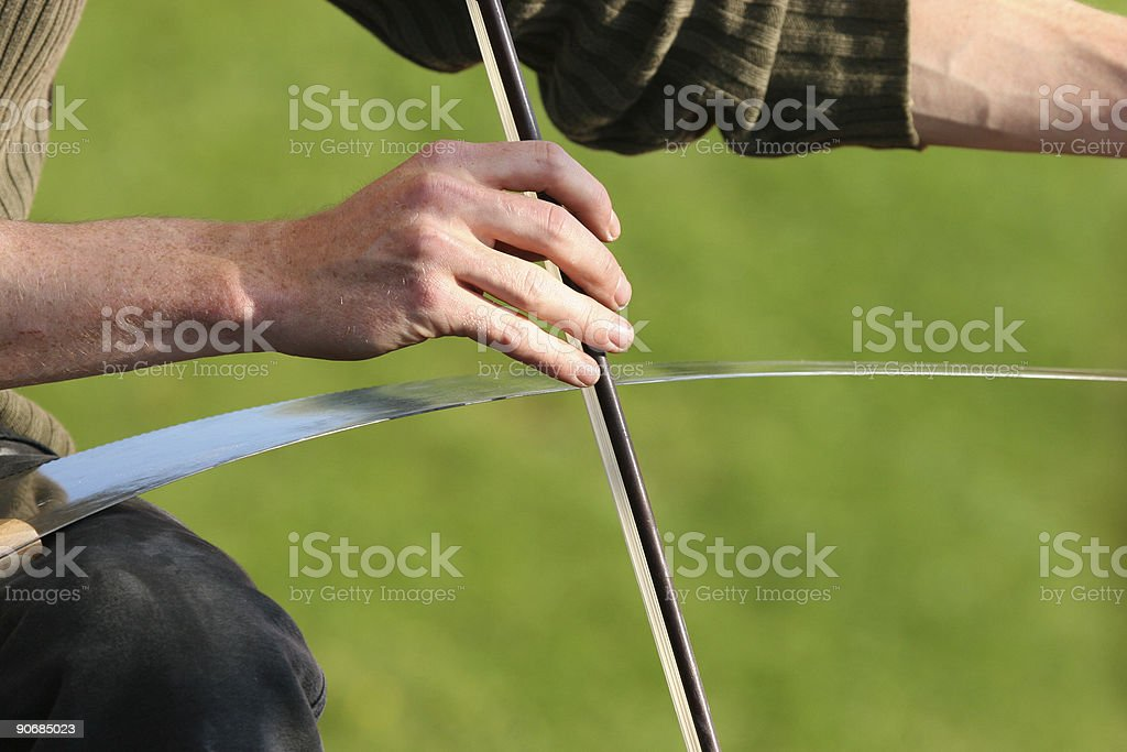 Medieval music man playing the saw close up on hand stock photo