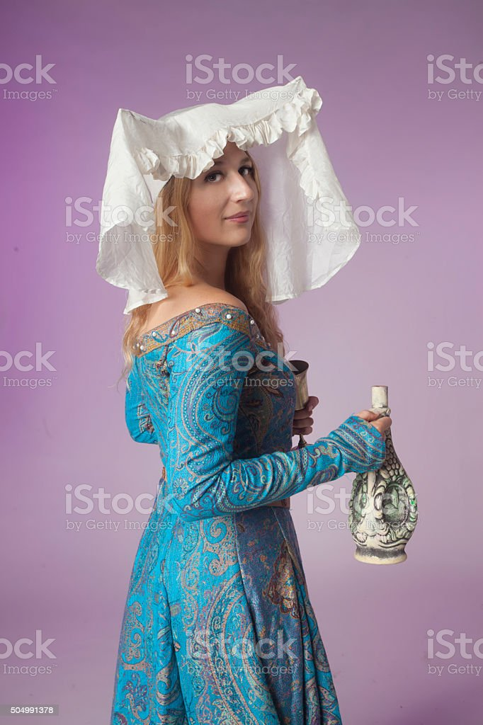Medieval noblewoman with a jar stock photo