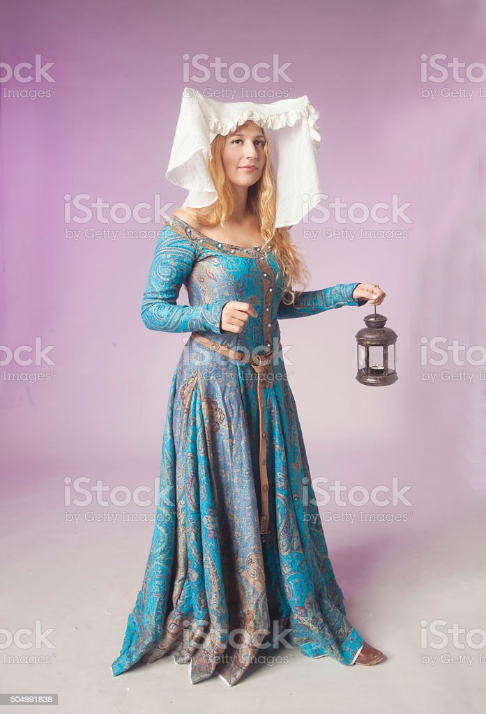 Medieval noblewoman with a lamp stock photo