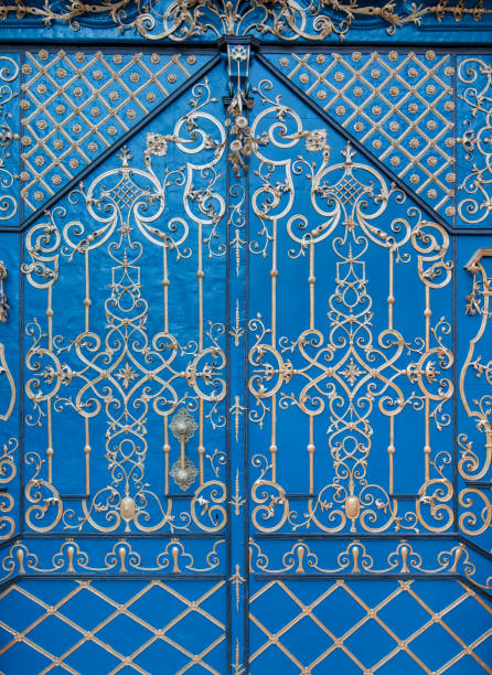 medieval old church door decorated with gold metal ornaments stock photo